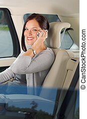 Executive businesswoman sit car backseat calling