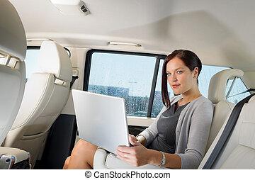 Executive businesswoman work laptop car backseat
