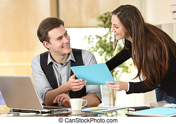 Executive giving documents to a businessman - Happy...