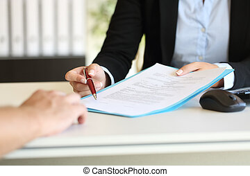 Executive hands indicating where to sign contract