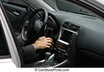 executive in a car - man's hand in new car interior, man...