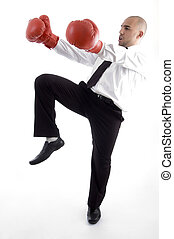 executive in action wearing boxing gloves against white ...