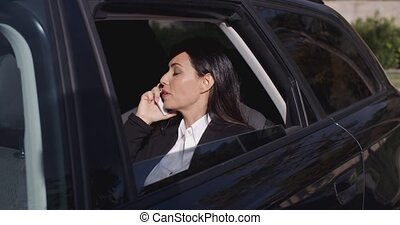 Executive in car blocking view from window - Annoyed female...