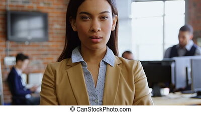 Executive looking at camera in office 4k