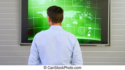 Executive looking at lcd screen in office 4k - Rear view of...