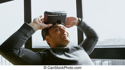 Executive removing virtual reality headset in office 4k -...