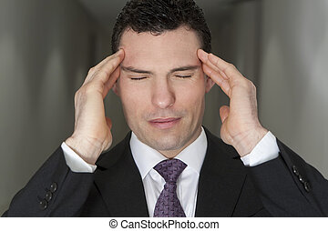 Executive Stress - Close up studio shot of a stressed ...