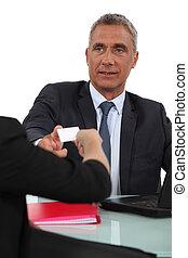 Executive taking card