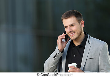 Executive talking in a phone call on the street