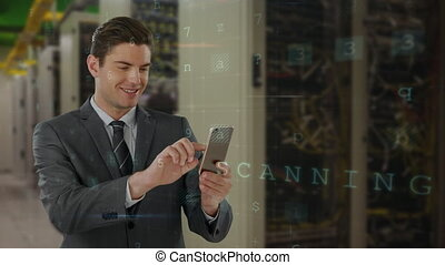 Executive using mobile phone in server room