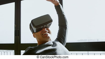 Executive using virtual reality headset in office 4k - Male...