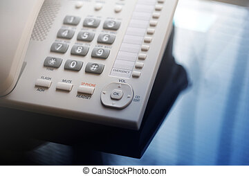Executive VoIP desk phone with traditional corded headset....