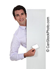 Executive with a blank business card and board