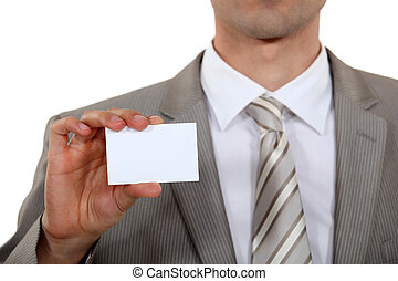 Executive with a blank business card