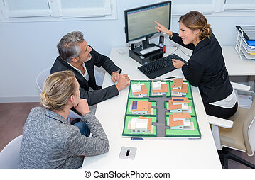 Executive with couple discussing property development