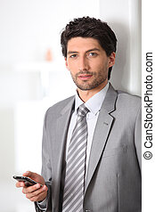 Executive with mobile phone