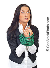 Executive woman with tied hands praying - Young executive...