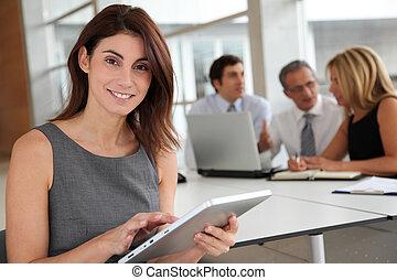 Executive woman working on electronic tab