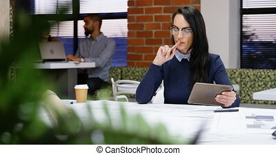 Executive working on table in office cafeteria 4k