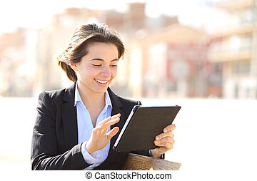 Executive working with a tablet in a park