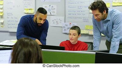 Executives discussing on desktop pc at desk 4k - Executives ...
