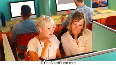 Executives discussing over desktop pc at desk 4k - ...