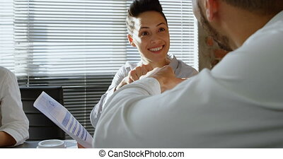 Executives interacting with each other in office 4k - ...
