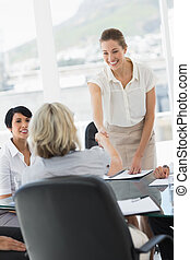 Executives shaking hands during a business meeting - Female...