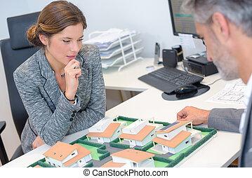 Executives studying model housing development