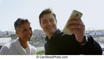 Executives taking selfie on terrace 4k - Executives taking...