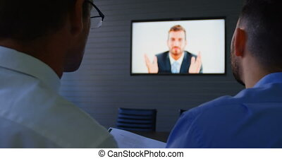 Executives talking during video conferencing 4k - Executives...