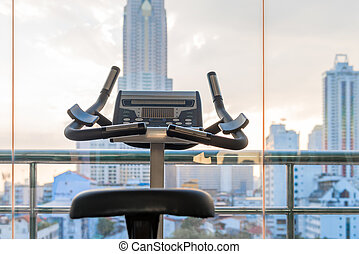 exercise bike with city view in the window