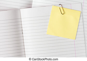 Exercise books with blank sticky note