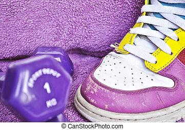 Exercise concept - Sneakers and dumbbells