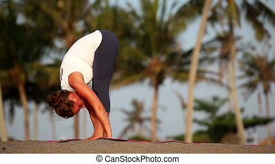 Exercise - Fit woman doing exercise of yoga on tropical...