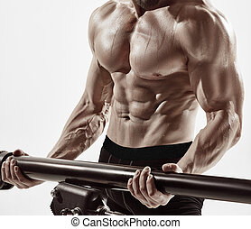 Exercise for triceps in the gym. Attractive muscular man...