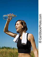 Beautiful caucasian girl cooling down with water