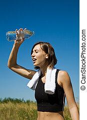 Exercise girl cooling down - Beautiful caucasian girl...