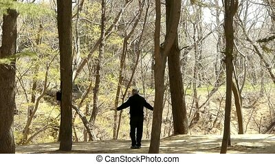 Exercise in pine forest.leisure,oriental,sport,people.