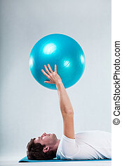 Exercise on floor exercise mat - Closeup of patient...