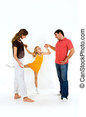 Exercise - Image of young girl doing exercise holding her...
