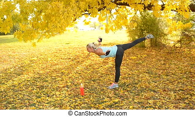 Exercise preparation - Attractive woman stretching her legs...