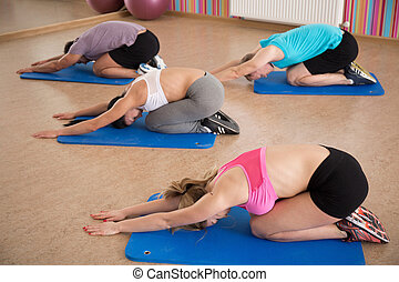 Exercise to prevent back pain - Young people doing exercise...