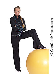 exercise with a yellow rubber ball