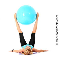 Exercise with ball - A picture of a beautiful young fit...