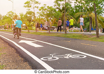 exercise with bicycle in public park, outdoor sport.
