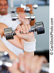 exercise with dumbbell in gym