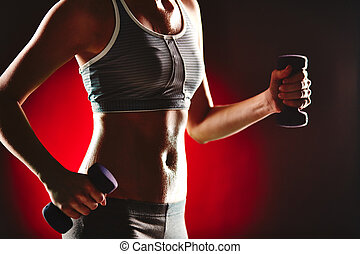 Exercise with dumbbells - Body of slim female in activewear ...