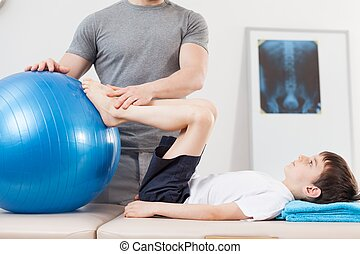 Exercise with fitness ball - Small patient doing exercise...