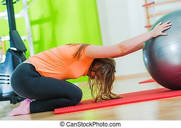 Exercise with the Fitness Ball. Caucasian Teenager in the...